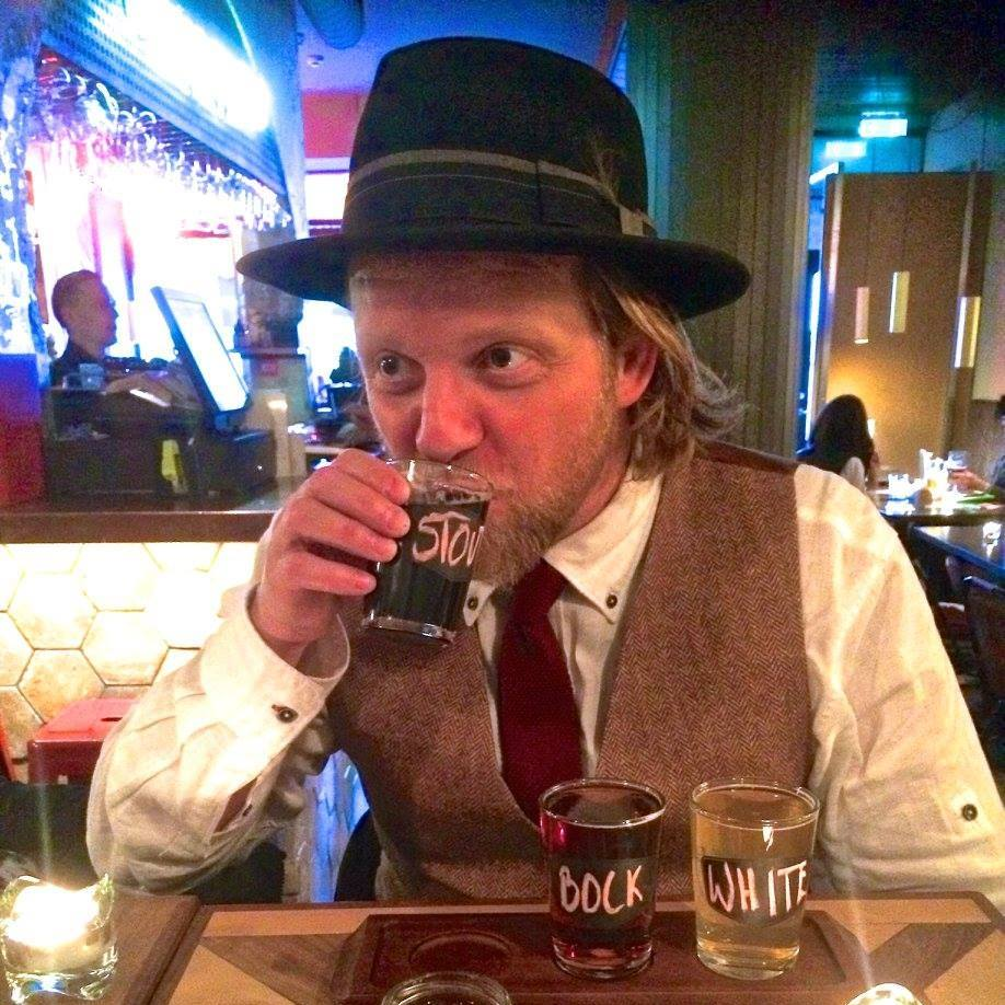 Ýmir tasting beers in The Public House – Gourmet Welcome Walk, Magical Iceland